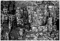 Large stone smiling faces on upper terrace, the Bayon. Angkor, Cambodia (black and white)