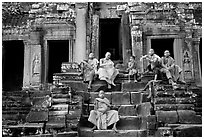 Buddhist monks sitting on steps, Angkor Wat. Angkor, Cambodia ( black and white)
