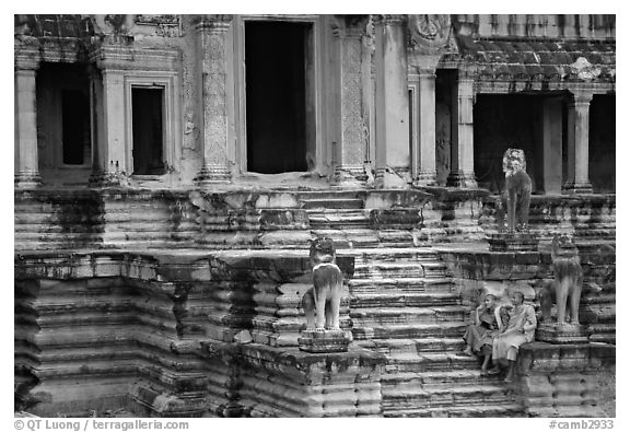 Buddhist monks on stairs, Angkor Wat. Angkor, Cambodia (black and white)