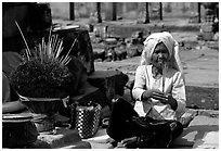 Incence vendor wearing traditional headcloth. Angkor, Cambodia ( black and white)