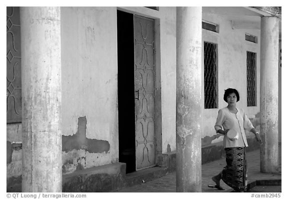 Woman in downtown building. Phnom Penh, Cambodia (black and white)