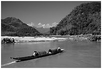Narrow live-in boat. Mekong river, Laos (black and white)