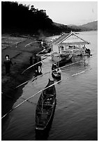 Boats and stilt house of a small hamlet. Mekong river, Laos ( black and white)