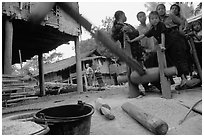 Preparation of rice in a small hamlet. Mekong river, Laos (black and white)