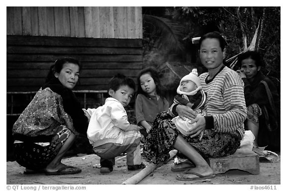 Group of women and children in a small hamlet. Mekong river, Laos (black and white)