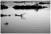 Fisherman casts net at sunset in Huay Xai. Laos (black and white)
