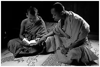 Buddhist novice monks reading. Luang Prabang, Laos (black and white)