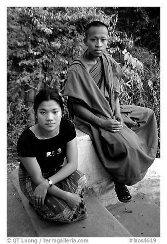 Buddhist novice monk and his sister. Luang Prabang, Laos (black and white)