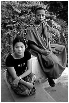 Buddhist novice monk and his sister. Luang Prabang, Laos ( black and white)