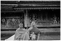 Two buddhist novice monks at Wat Xieng Thong. Luang Prabang, Laos ( black and white)