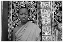Buddhist novice monk at Wat Xieng Thong. Luang Prabang, Laos ( black and white)