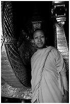 Buddhist novice monk, grinning because demonstrating ordained monks style of robe draping. Luang Prabang, Laos ( black and white)