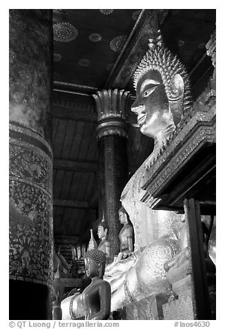 Buddha statues on altar, Wat Xieng Thong. Luang Prabang, Laos (black and white)