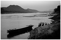 Dusk on the Mekong river framed by coconut trees. Luang Prabang, Laos ( black and white)