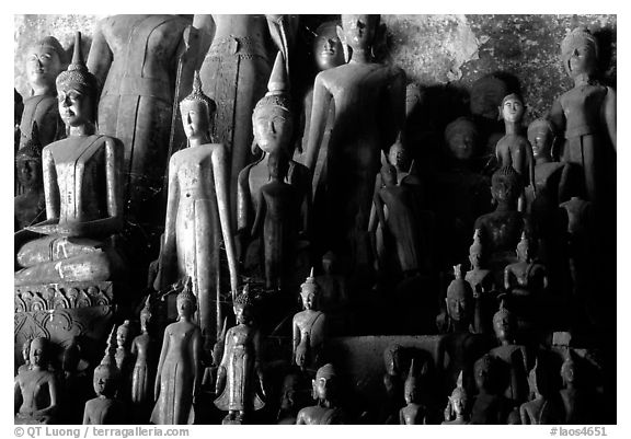 Lao style Buddha sculptures assembled over the centuries by local people, Pak Ou. Laos