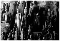 Lao style Buddha sculptures assembled over the centuries by local people, Pak Ou. Laos (black and white)