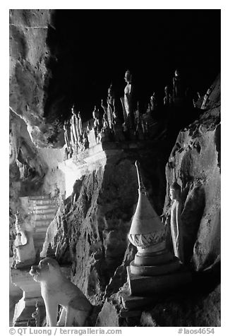 Buddhist statues left by pilgrims, lower Pak Ou cave. Laos