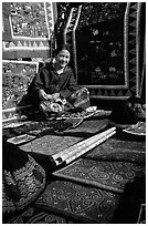 Young woman sells crafts on market. Luang Prabang, Laos ( black and white)