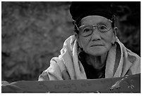 Older woman wears a mix of tribal and western garb. Luang Prabang, Laos ( black and white)