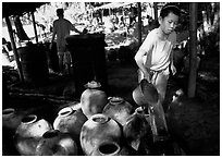 Making of the Lao Lao, strong local liquor in Ban Xang Hai village. Laos ( black and white)