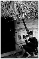 Woman of the Lao Huay tribe in front of her hut,  Ban Nam Sang village. Laos (black and white)
