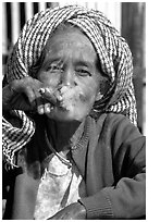Woman smoking a cheerot,  Kalaw. Shan state, Myanmar (black and white)