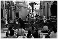 Water offering at Planetery post, Shwedagon Paya. Yangon, Myanmar (black and white)