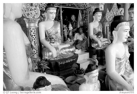Surrounded by Buddha statues, Shwedagon Paya. Yangon, Myanmar