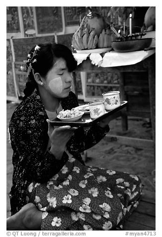 Burmese woman offering food. Bagan, Myanmar (black and white)