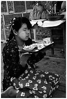 Burmese woman offering food. Bagan, Myanmar ( black and white)