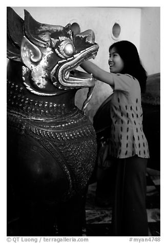 Rubbing an Angkor bronze statue at Mahamuni Paya. Mandalay, Myanmar (black and white)