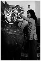Rubbing an Angkor bronze statue at Mahamuni Paya. Mandalay, Myanmar ( black and white)