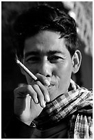 Man enjoying a cheerot (burmese cigar). Mandalay, Myanmar (black and white)