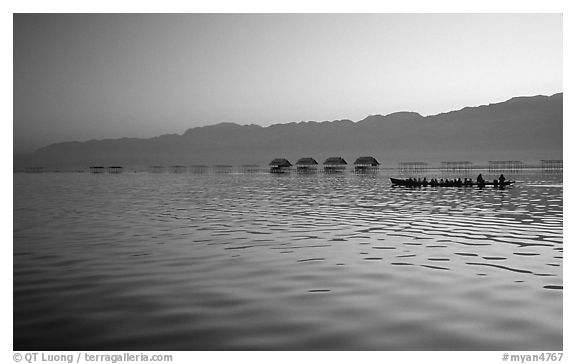 Long boat,  stilts huts, and mountains, sunrise. Inle Lake, Myanmar