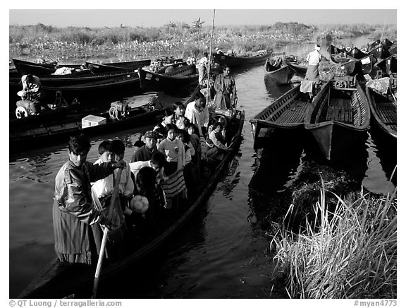 Children commuting to school on small boat. Inle Lake, Myanmar (black and white)