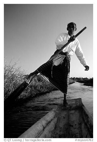 Intha man demonstrating leg-rowing. Inle Lake, Myanmar (black and white)