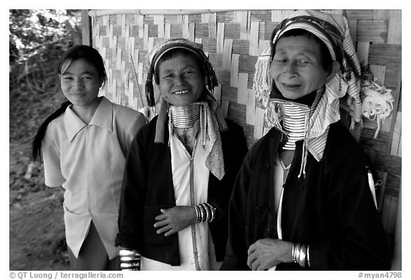 Three generations of Padaung women	along hut. Shan state, Myanmar (black and white)