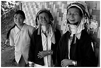 Three generations of Padaung women	along hut. Shan state, Myanmar ( black and white)