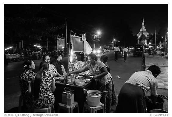 Streat food served at night, Shwedagon Pagoda in background. Yangon, Myanmar (black and white)
