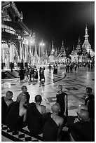 Monks, Terrace and Naungdawgyi (Elder Brother) Pagoda at night, Shwedagon Pagoda. Yangon, Myanmar ( black and white)
