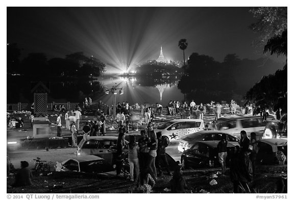 Shores of Kandawgyi with revelers on 2014 New Year night. Yangon, Myanmar (black and white)