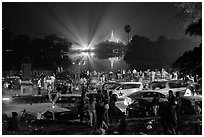 Shores of Kandawgyi with revelers on 2014 New Year night. Yangon, Myanmar ( black and white)