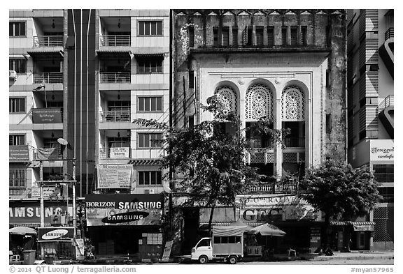 Modern and colonial-area facades in city center. Yangon, Myanmar (black and white)