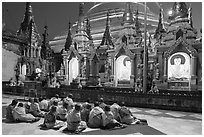 Nuns praying, Shwedagon Pagoda. Yangon, Myanmar ( black and white)