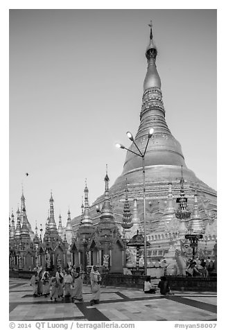 Nuns walking at the base of main chedi, Shwedagon Pagoda. Yangon, Myanmar (black and white)