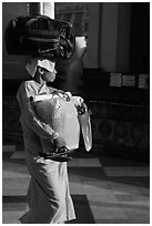 Nun carrying lots of luggage, Shwedagon Pagoda. Yangon, Myanmar ( black and white)