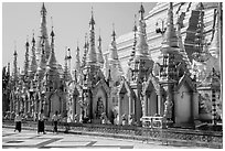 Men walking near stupas, Shwedagon Pagoda. Yangon, Myanmar ( black and white)