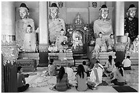 Praying at a Devotion Hall. Yangon, Myanmar ( black and white)