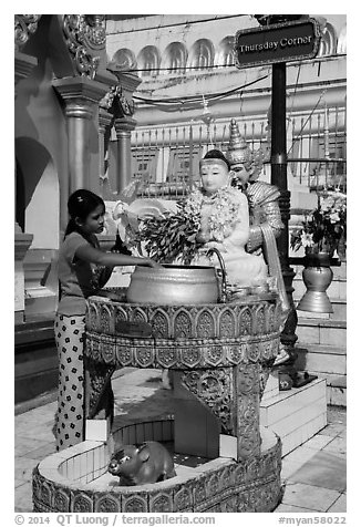 Woman worshipping at planetary post. Yangon, Myanmar (black and white)