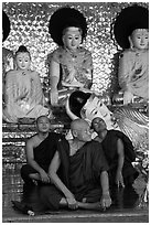 Monks and buddha statues, Shwedagon Pagoda. Yangon, Myanmar ( black and white)